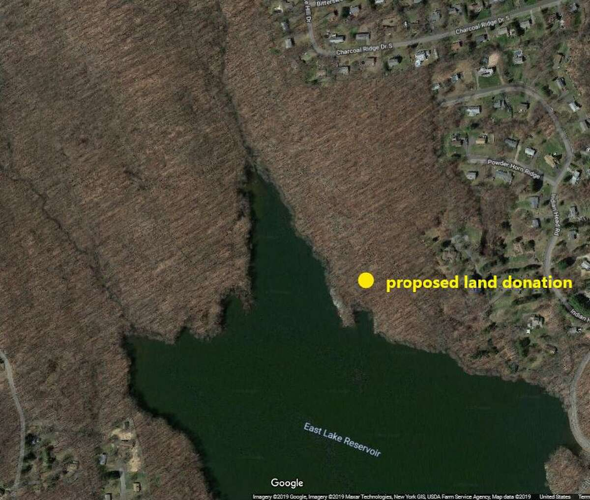 A Danbury couple has proposed donated 6 acres of lakefront property to the city.
