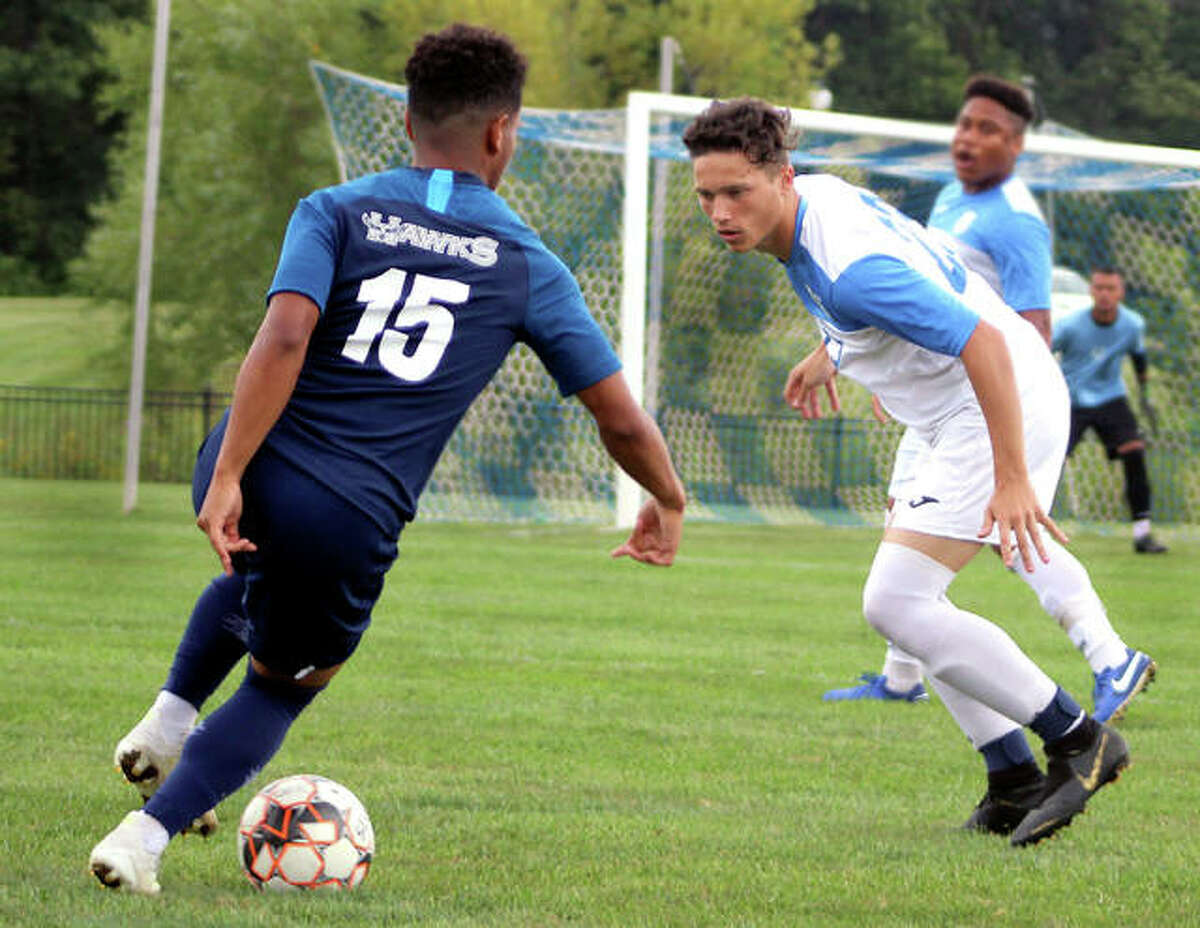 Will Grant of Lewis and Clark, right, keeps his eye on the ball as Heartland's Bryan Alfaro looks for an opening during Saturday's game at Tim Rooney Stadium. LCCC's men are ranked No. 20 in this week's NJCAA Division I National Poll and the women's team is ranked No. 11.