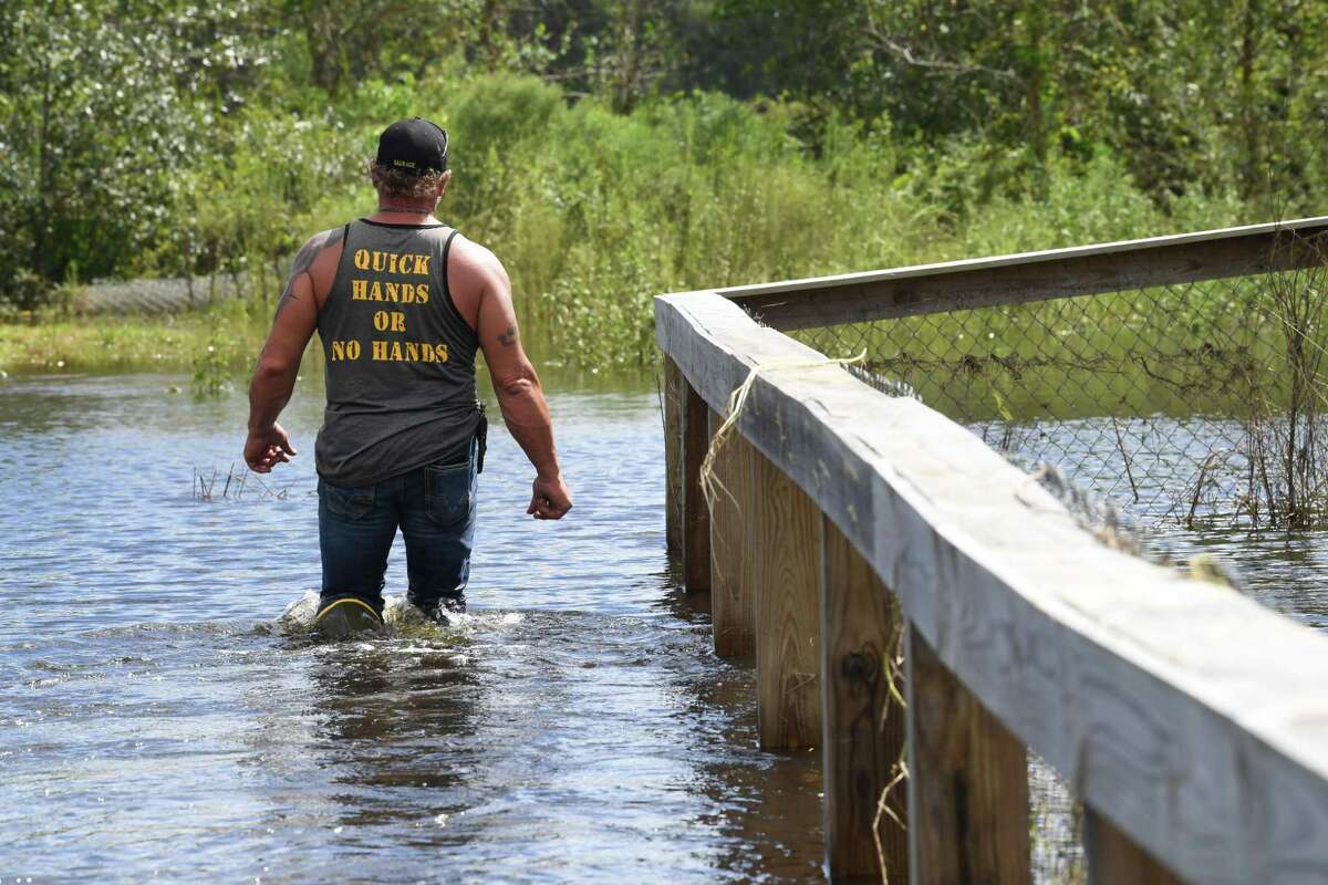 Gary Saurage walks through a flooded Gator Country Monday afternoon after Tropical Depression Imelda inundated Southeast Texas with rain water. Suarge, the company owner, said that Tropical Depression Imelda dropped a foot more water on the grounds than Tropical Storm Harvey. Photo taken Monday, 9/23/19