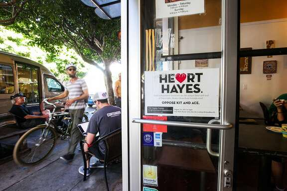 "Cafe La Vie, has a sign saying ""Heart Hayes"" on the door in a protest to stop the store, Kit and Ace from moving in down the street, in San Francisco, California on August 27, 2015.Merchants throughout Hayes Valley argue that Kit and Ace should be considered a chain store, and not permitted in the area."