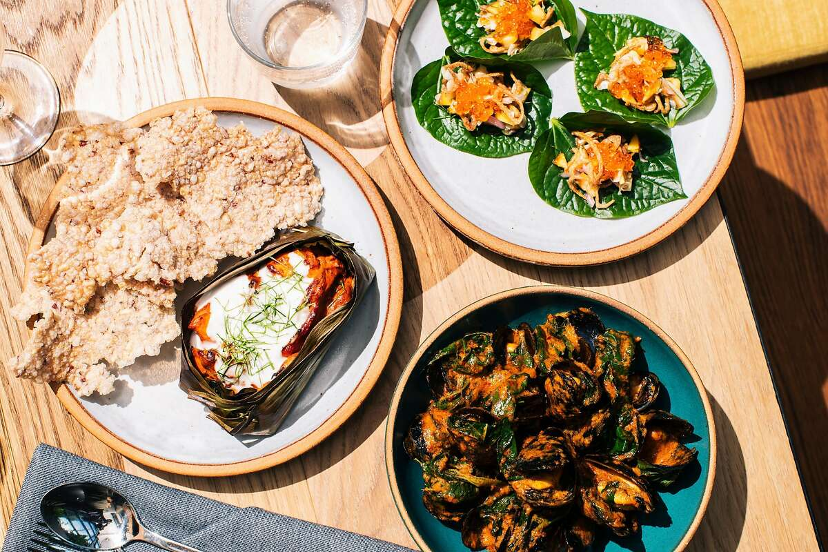 Clockwise from top right: Miang with stone fruits and cured trout roe, gaeng kua with mussels, and khao tung and ngob photographed at Nari in San Francisco, Calif. on Wednesday, September 18, 2019.
