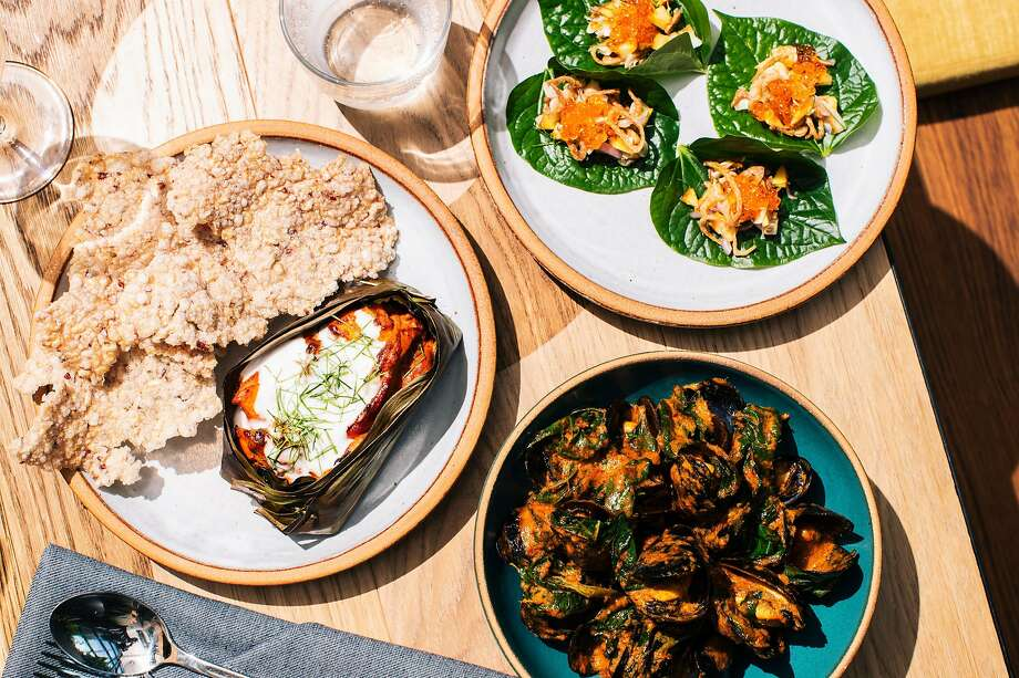 Miang with stone fruits and cured trout roe (clockwise from top right), gaeng kua with mussels, and khao tung and ngob at Nari in San Francisco. Photo: Stephen Lam / Special To The Chronicle
