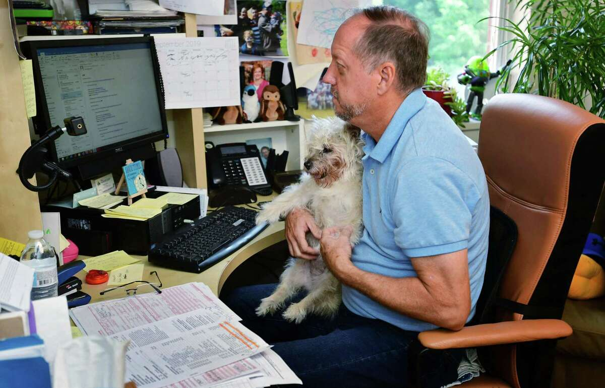 Southfield Center Office Manager Mike Brouse and his dog, Mimi, at the Southfield facility Wednesday, September 11, 2019, in Darien, Conn. The Southfield Center for Development is a family-centered, interdisciplinary practice dedicated to providing comprehensive evaluations and integrated interventions addressing a wide range of ages and challenges.