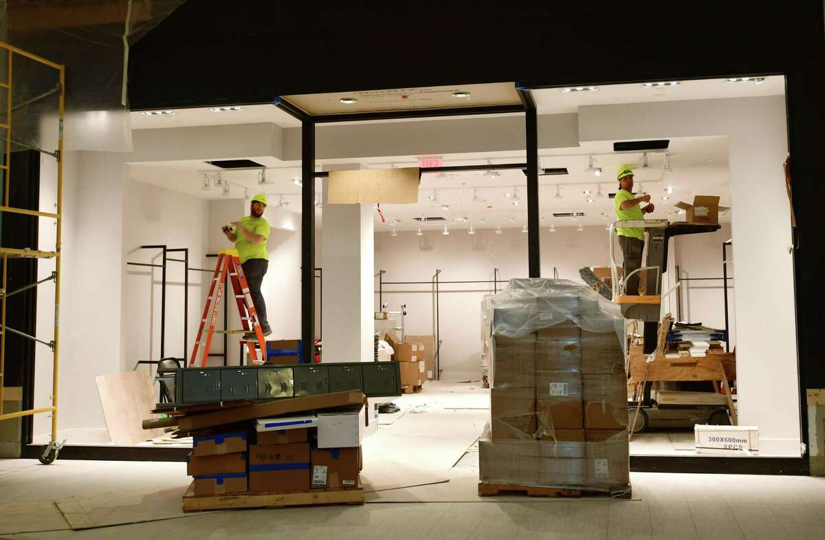 Construction workers fit out a SoNo Collection storefront on Tuesday, Sept. 24, 2019, in advance of the Norwalk, Conn. mall's opening date on Oct. 11.