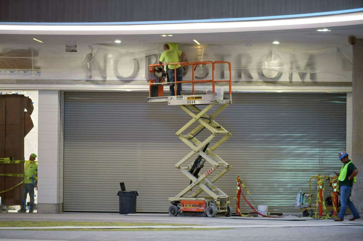 Construction workers work on a SoNo Collection entry to Nordstrom on Tuesday, Sept. 24, 2019, in advance of the Norwalk, Conn. mall's opening date on Oct. 11.