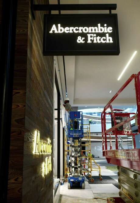 Construction workers fit out a SoNo Collection storefront on Tuesday, Sept. 24, 2019, in advance of the Norwalk, Conn. mall's opening date on Oct. 11. Photo: Erik Trautmann / Hearst Connecticut Media / Norwalk Hour