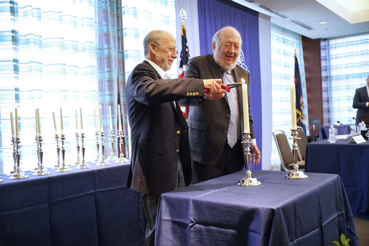 Dr. Bert Vogelstein, left, of Johns Hopkins University and Howard Hughes Medical Institute and Dr. Irving Weissman of Stanford University, light a candle at the 19th annual Albany Medical Center Prize on Tuesday, Sept. 24, 2019, in Albany, N.Y. This years recipients were Dr. Vogelstein and Dr. Weissman and were awarded the prize for their cancer research. (Paul Buckowski/Times Union)