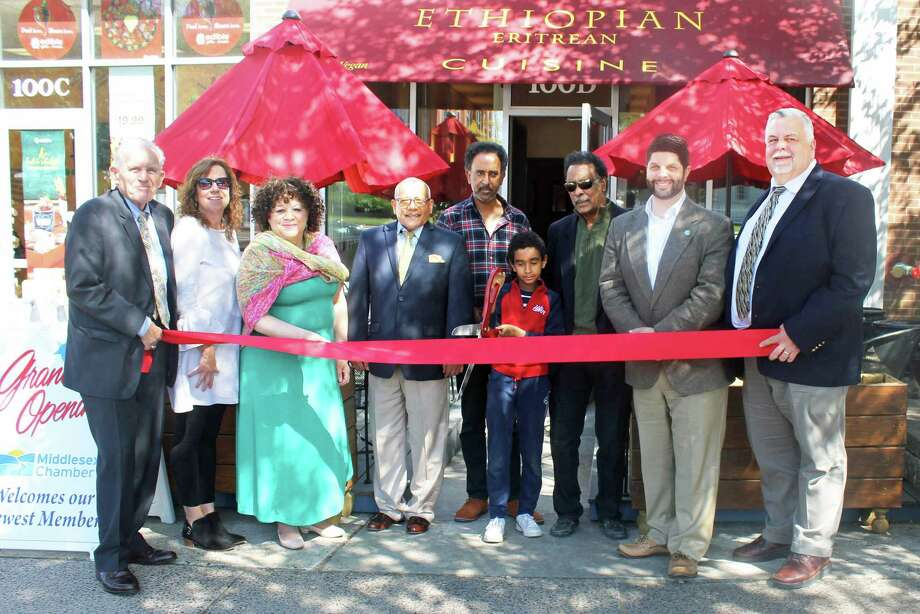 The Middlesex County Chamber of Commerce recently held a grand opening for Abyssinian Ethiopian restaurant, located next store to the Inn at Middletown. From left are Chamber President Larry McHugh, Lisa Melaven of the Downtown Business District, Pamela Steele, chairwoman of the Central Business Bureau, David Ghebretzadick, Russom Mussie, Noah Mussie, owner Menasie Weldeyohannes, Mayor Dan Drew, and Chamber Chairman Don DeVivo. Photo: Contributed Photo