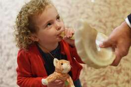 A little girl blows a shofar, an instrument typically made from a ram's horn that is blown ceremonially at Rosh Hashanah, which is Sept. 29-30 and Yom Kippur, which is Oct. 3. Temple B'nai Chaim will introduce a new prayer book for its High Holy Day family services.