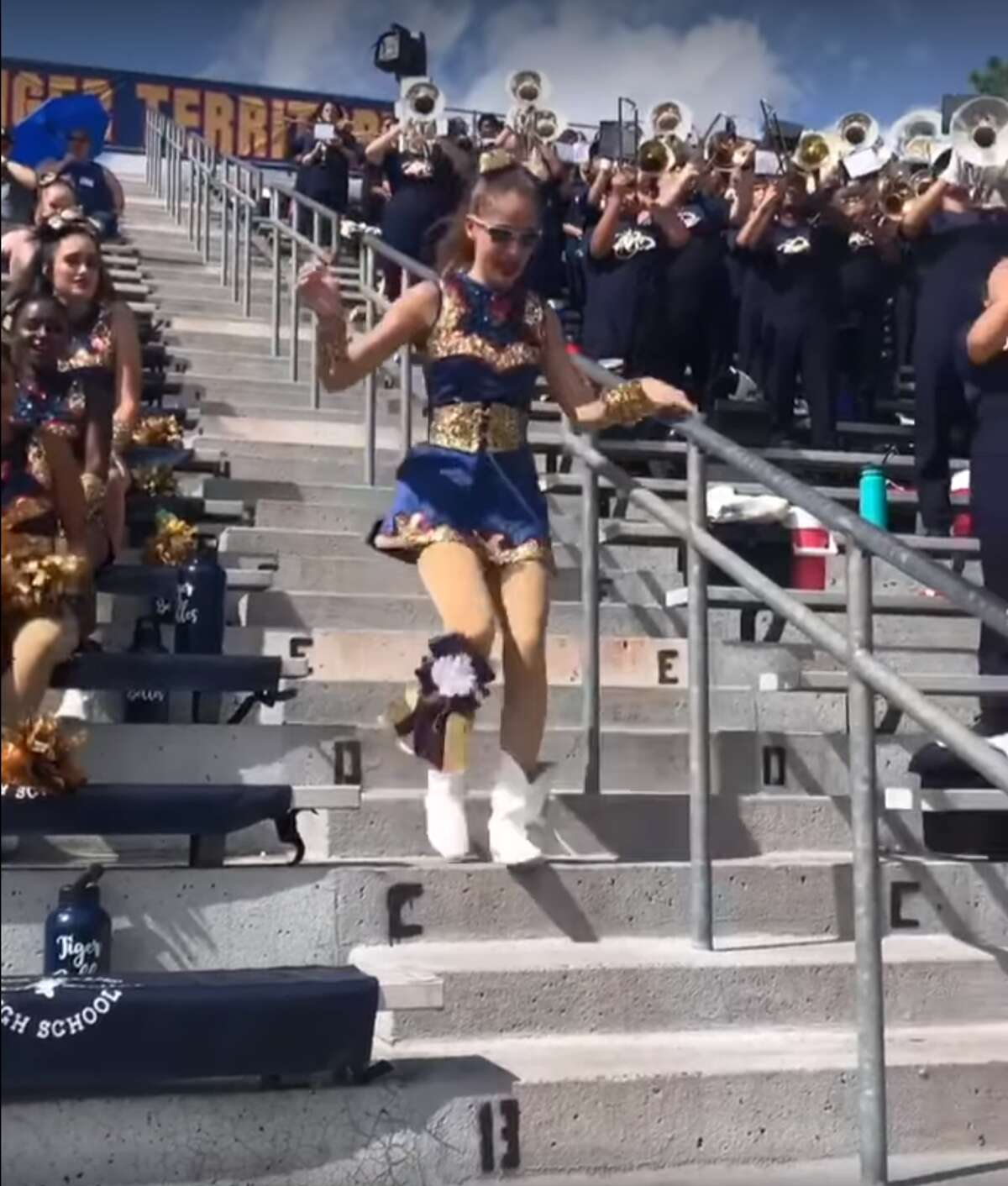 Jillian Herman gleefully ran down the bleacher stairs as soon as she saw her brother to give him a powerful, welcoming embrace.