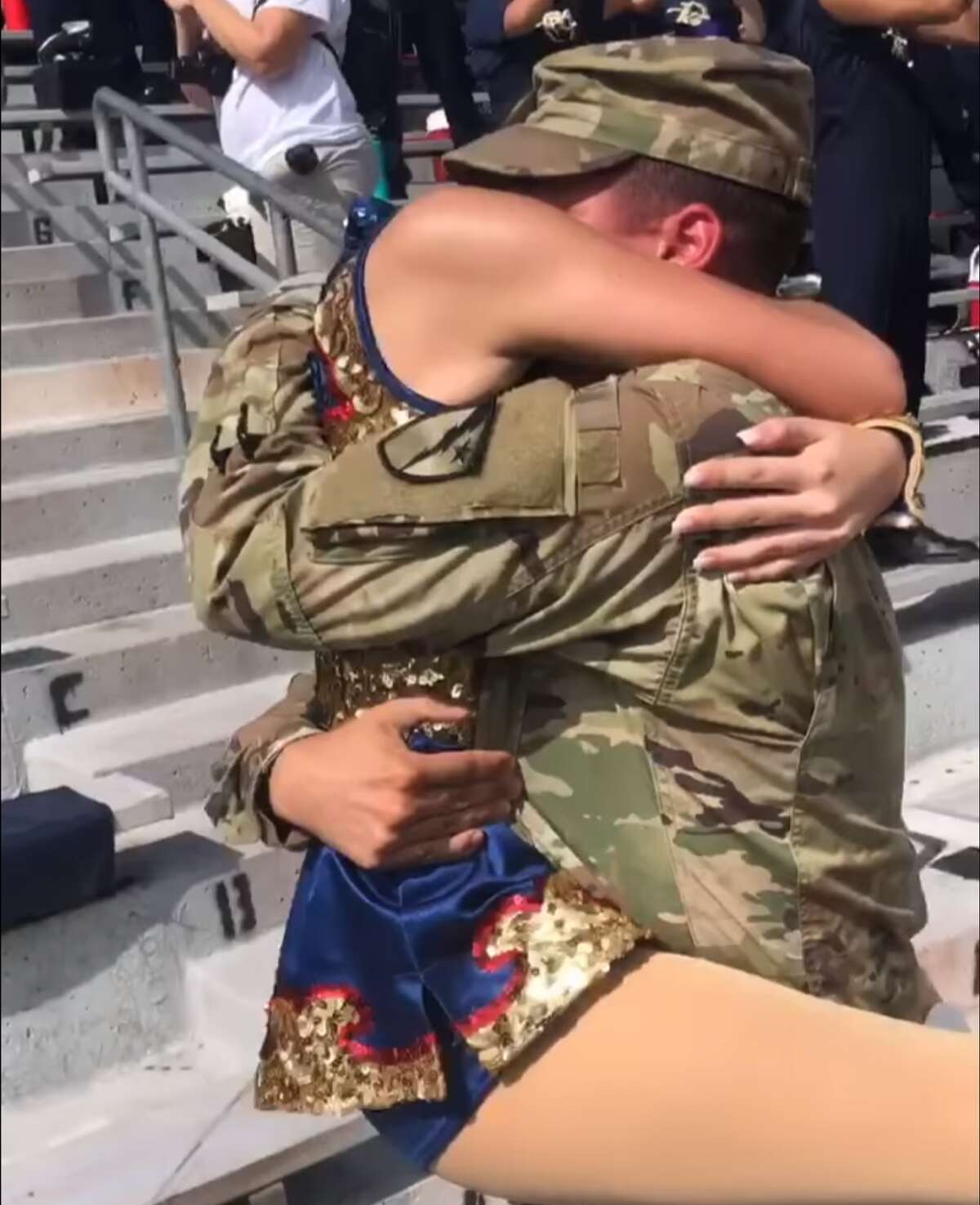 U.S. Army Specialist Jared Herman, who had been deployed overseas for a year, gave his sister a homecoming surprise during her high school's homecoming football game on Saturday.