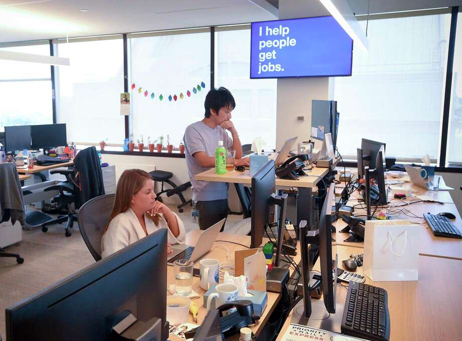 Employees of Indeed at its Stamford offices. The company is growing fast in Connecticut. Photo: Matthew Brown / Hearst Connecticut Media / Stamford Advocate