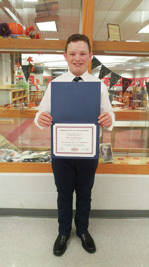 Eli Lawrence holding his award for Alton Middle School's Optimist Student of the Month for September. Lawrence received the recognition for his hard work and willingness to help others, as demonstrated in part by his willingness to learn sign language to communicate with a classmate. Photo: Photo By Jeanie Stephens