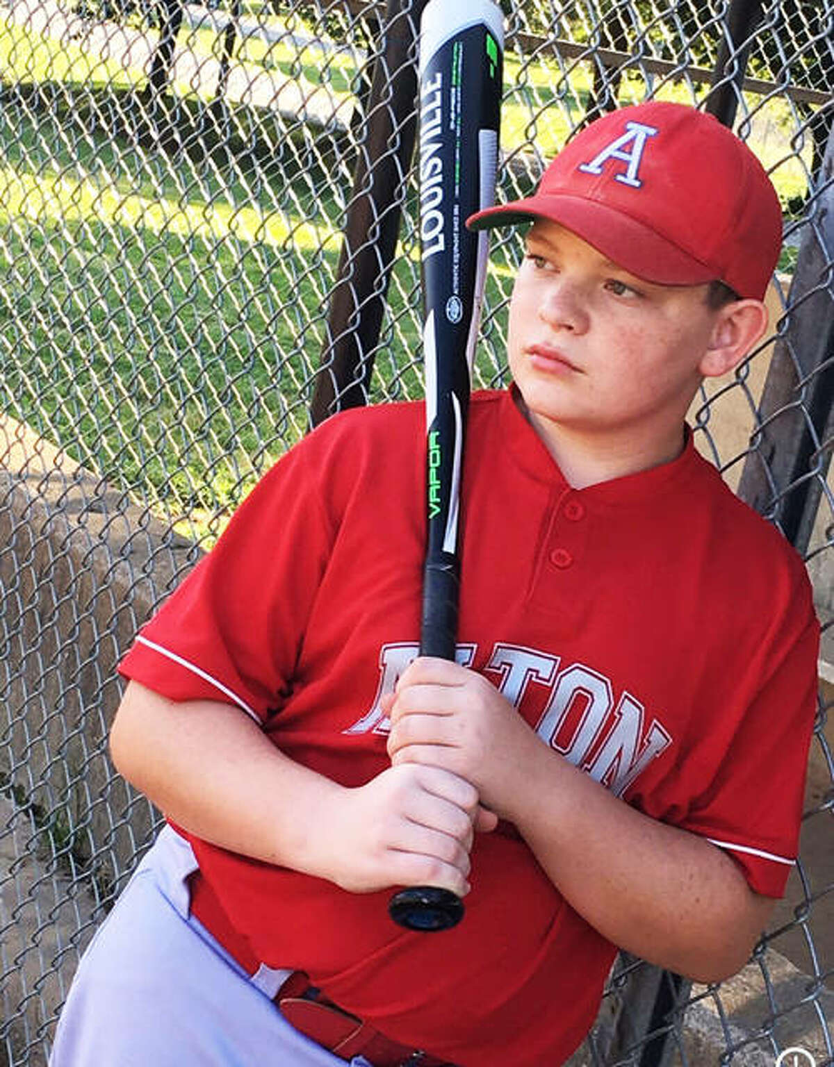 Eli Lawrence on the field as an Alton Redbird. Recognized as Alton Middle School's Optimist Student of the Month for September, Lawrence dreams of playing major league baseball someday and helping deaf athletes.
