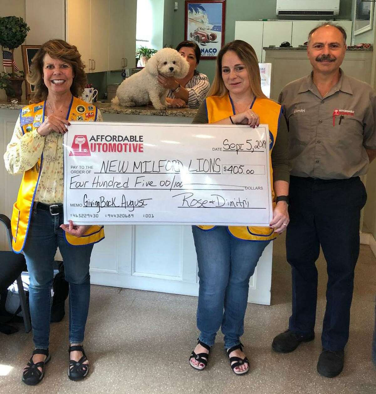 The New Milford Lions Club recently received a check for $405 from Affordable Automotive. The donation was made through the business' Giving Back Program. Each month, Affordable Automotive gives $5 per oil change to a local organization. For August, the business performed 81 oil changes, thus the club received $405. Above are, from left to right, Lions President Tammy Deak, Affordable Automotive co-owner Rose Koulouris, Lion Helena Short and Affordable Automotive co-owner Dimitri Koulouris.