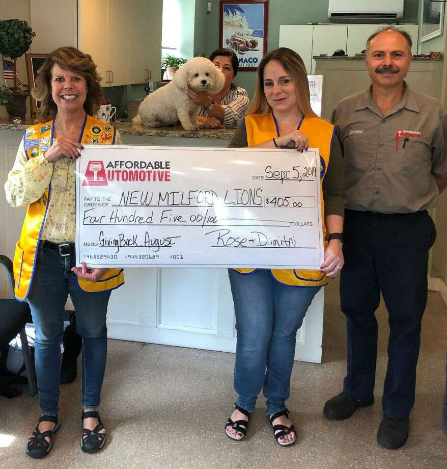 The New Milford Lions Club recently received a check for $405 from Affordable Automotive. The donation was made through the business' Giving Back Program. Each month, Affordable Automotive gives $5 per oil change to a local organization. For August, the business performed 81 oil changes, thus the club received $405. Above are, from left to right, Lions President Tammy Deak, Affordable Automotive co-owner Rose Koulouris, Lion Helena Short and Affordable Automotive co-owner Dimitri Koulouris. Photo: Courtesy Of The New Milford Lions Club / The News-Times Contributed