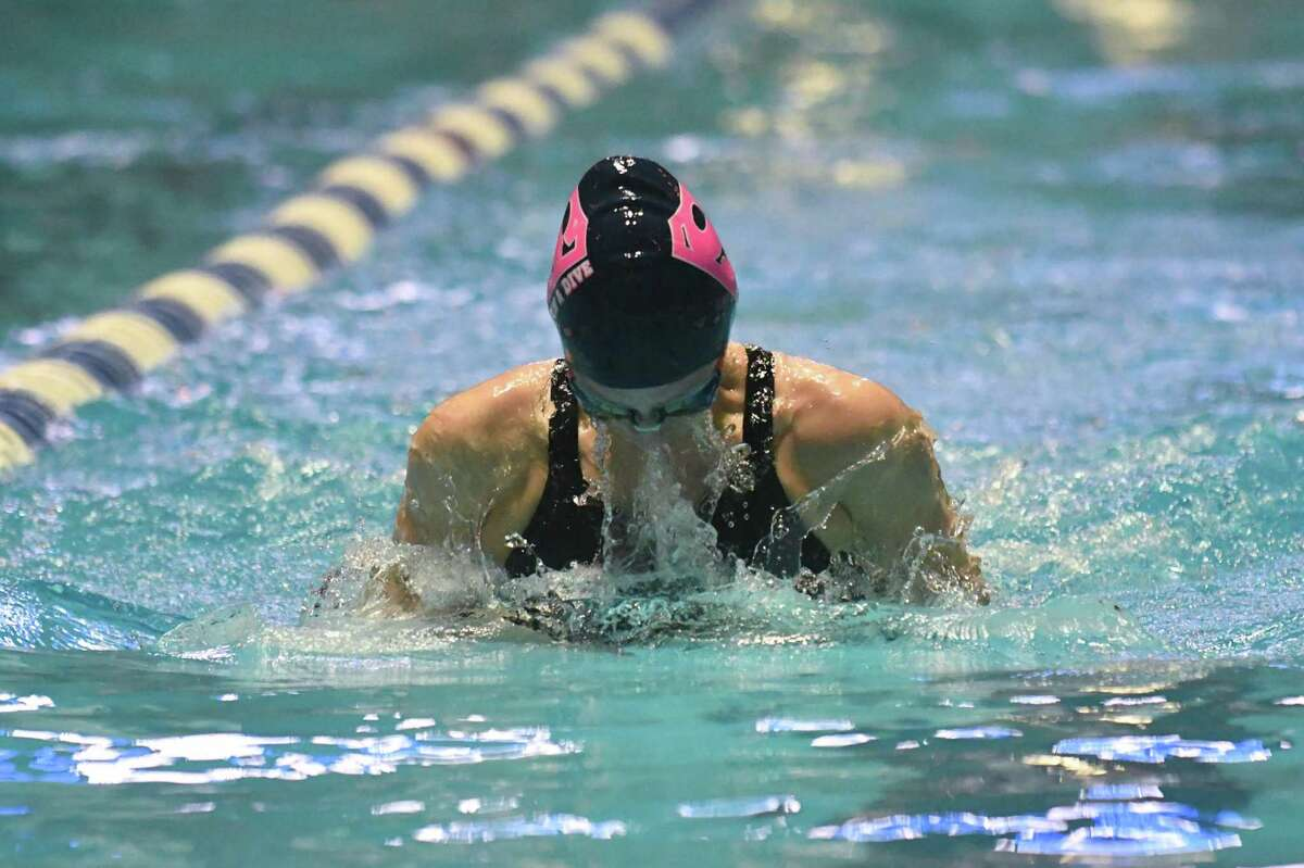 Staples' Anne Bowens swims the breaststroke leg of the 200-yard medley relay during the State Open in 2018.