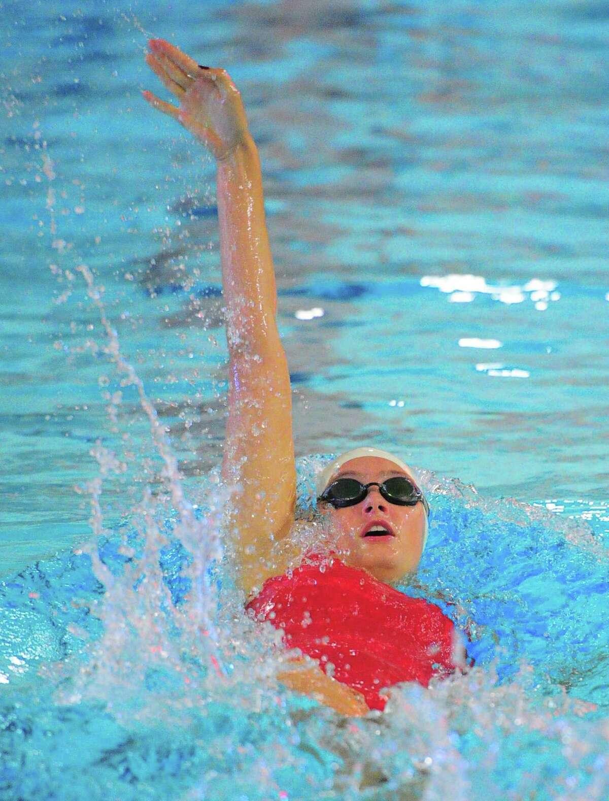 Greenwich's Samantha Ennis competes in the 100-meter backstroke against Ridgefield on Sept. 18 in Ridgefield.