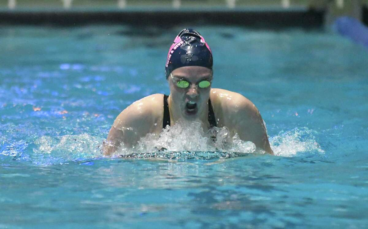 Esme Hunter of the Staples Wreckers swims the breaststroke leg of the 200 yd Individual Medley during the CIAC Open Swimming Championships on Saturday November 17, 2018, at Yale University in New Haven, Connecticut.