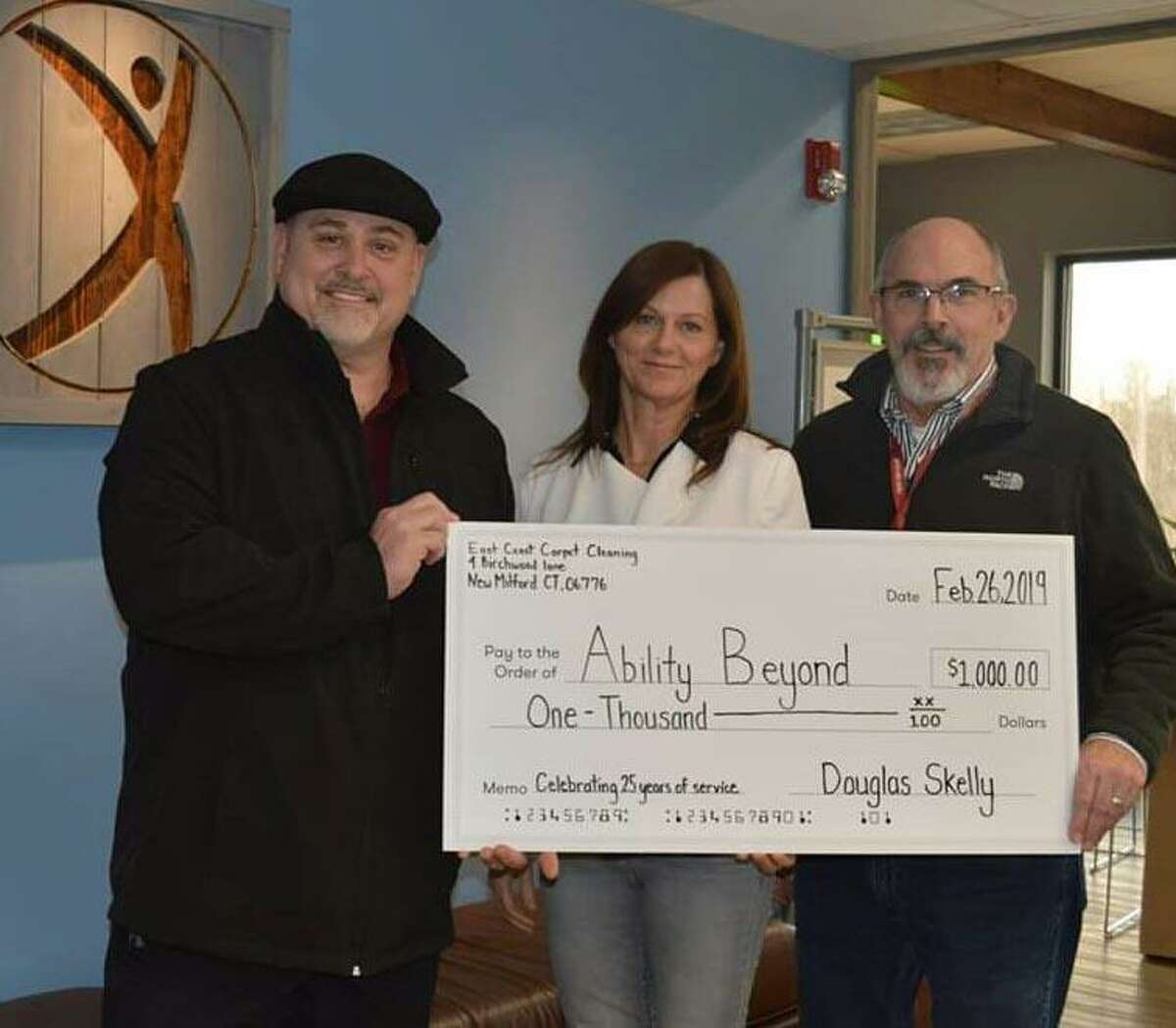 Doug Skelly, left, owner of East Coast Carpet and Upholstery Cleaning in New Milford recently presented a $1,000 donation to Ability Beyond.