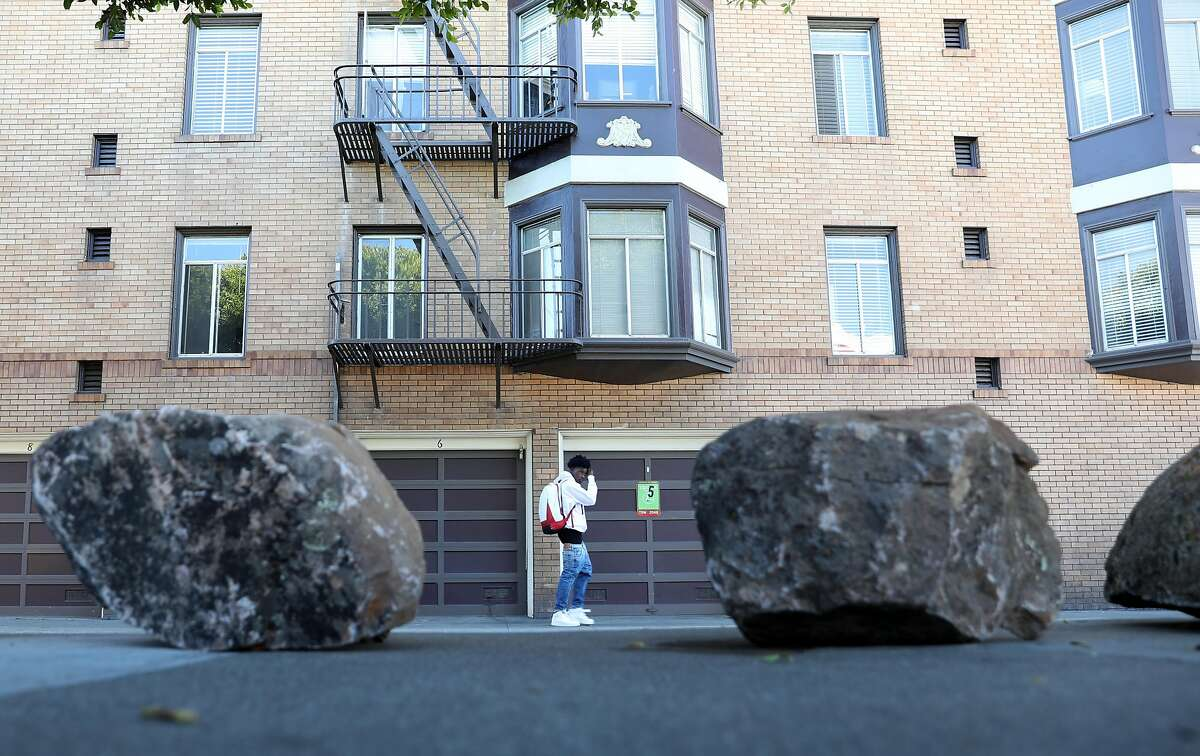 Boulders line the street of Clinton Park just off of Dolores St. on Tuesday, 9 24, 2019, in San Francisco, Calif. Someone has put boulders up on the sidewalk to keep the homeless tents out and the Department of Public works has no plans to remove them.