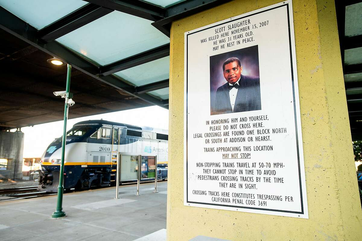 A sign memorializing Scott Slaughter hangs at the Amtrak station in Berkeley, Calif., on Tuesday, Sept. 24, 2019.