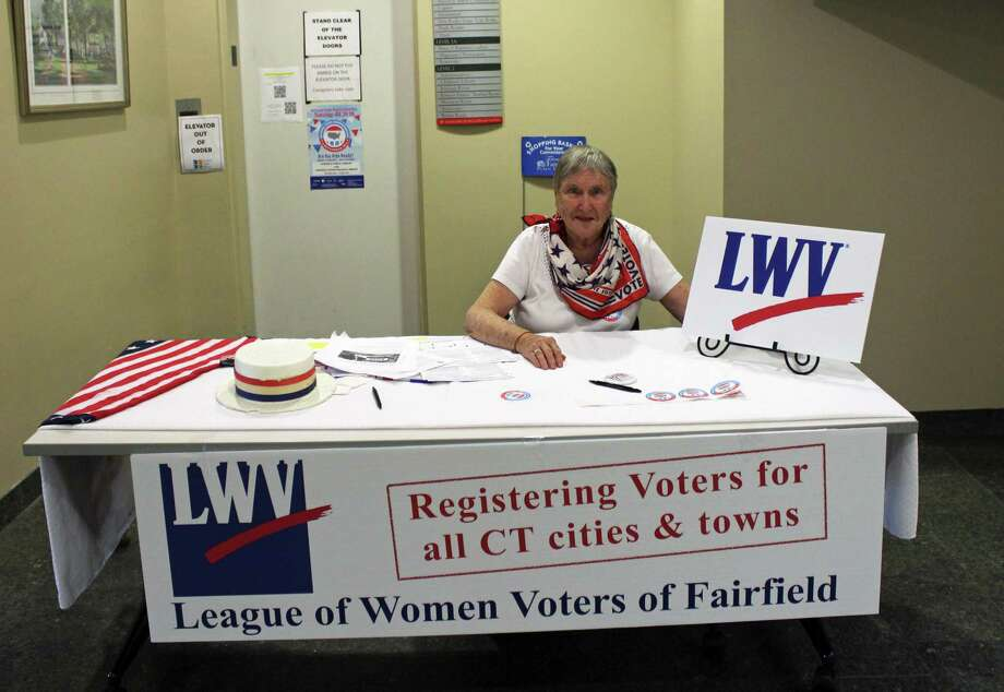 The League of Women Voters set up registration tables at Fairfield Main Library and Fairfield Woods Branch Library on Tuesday. Photo: Rachel Scharf / Hearst Connecticut Media