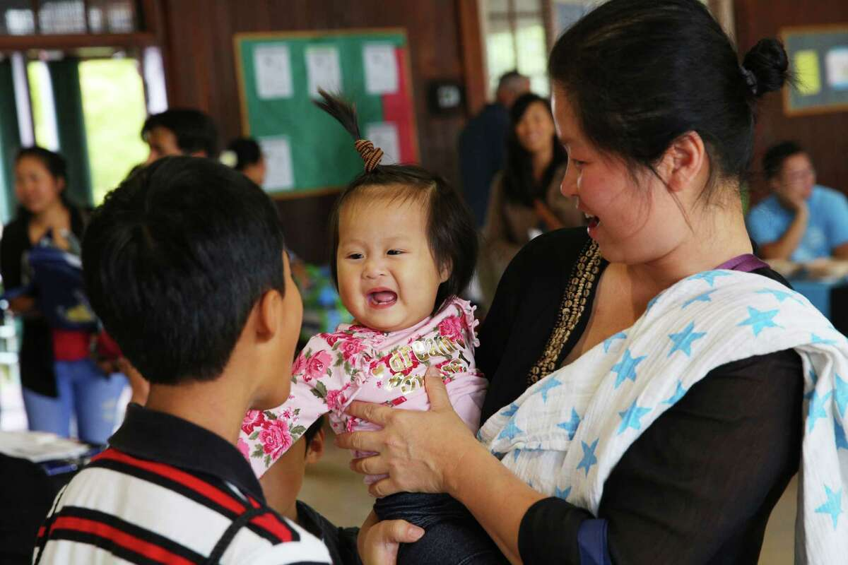 Families visit the Khmer Heath Fair in White Center, Saturday, Sept. 21, 2019. This first ever fair in Seattle aimed increasing health equity in the Khmer community and providing health screenings, education and prevenative services.