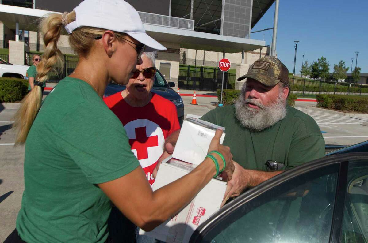 James Warfrom of Porter accepts flood cleanup supplies at Randall Reed Stadium, Tuesday, Sept. 24, 2019, in New Caney. An estimated 1,000 residents were expected to pick up supplies provided by American Red Cross, Interfaith The Woodlands and Community Assistants Center servicing Montgomery County.