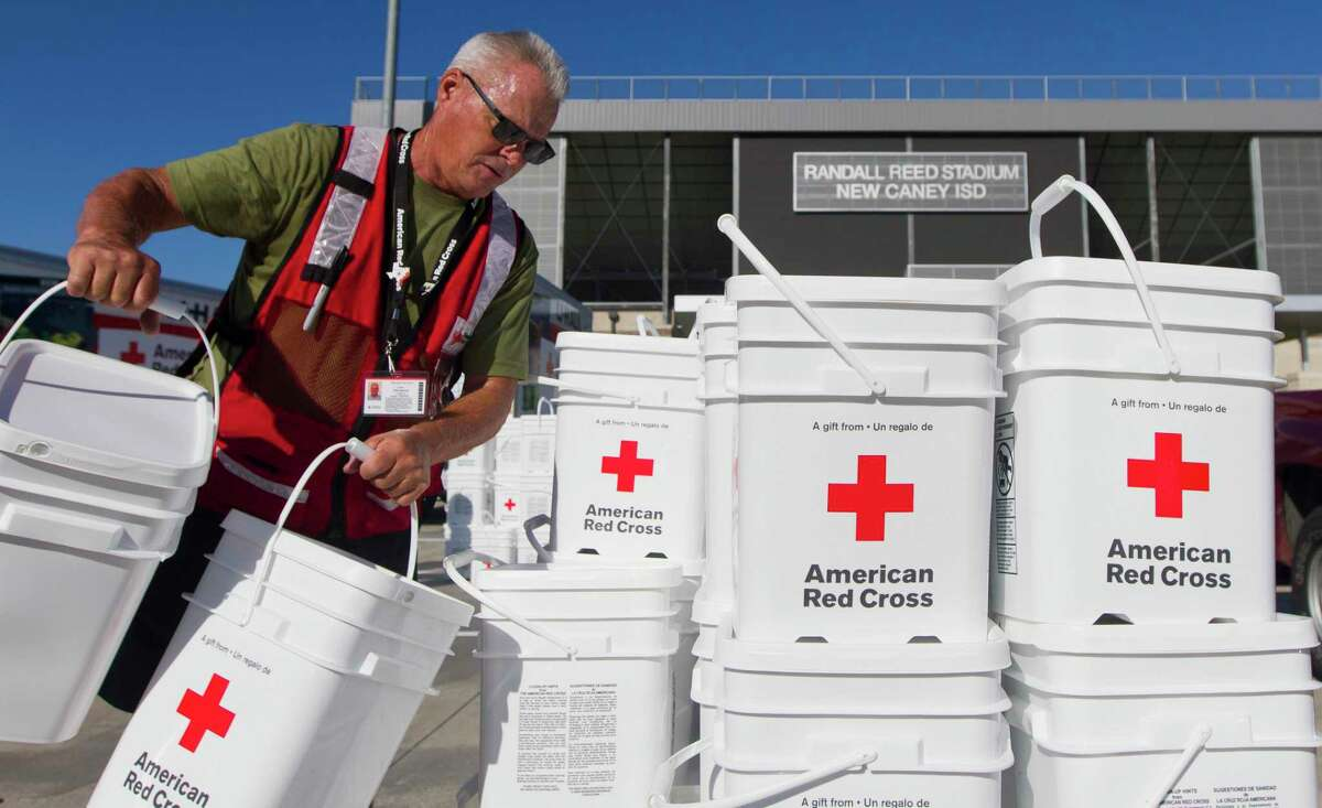 Dale Hackney with American Red Cross stacks relief buckets at Randall Reed Stadium, Tuesday, Sept. 24, 2019, in New Caney. An estimated 1,000 residents were expected to pick up supplies provided by American Red Cross, Interfaith The Woodlands and Community Assistants Center servicing Montgomery County.
