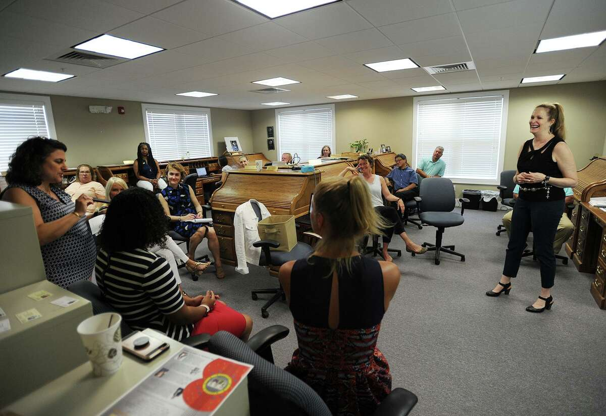Manager Nancy Pantoliano, right, leads a bi-monthly staff meeting at Berkshire Hathaway HomeServices in Norwalk.