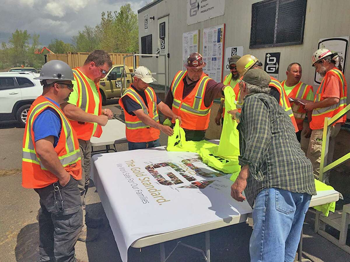 O&G Industries Inc. employees at the Newington Route 175 Bridge project sign a safety banner after the company won a 2018 Connecticut Construction Industry Association Platinum Safety Award.