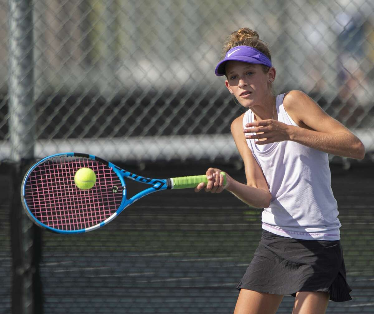 Midland High's Sarah Stewart returns a shot 09/24/19 during a match at Bush Tennis Center. Tim Fischer/Reporter-Telegram