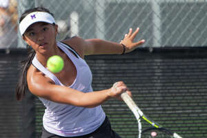 Midland High's Shaquila Sarapao returns a shot 09/24/19 during a match at Bush Tennis Center.  Tim Fischer/Reporter-Telegram
