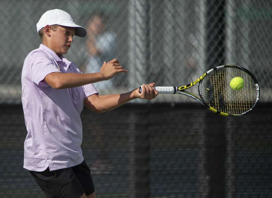 Midland High's Tyler Stewart returns a shot 09/24/19 during a match at Bush Tennis Center.  Tim Fischer/Reporter-Telegram Photo: Tim Fischer/Midland Reporter-Telegram