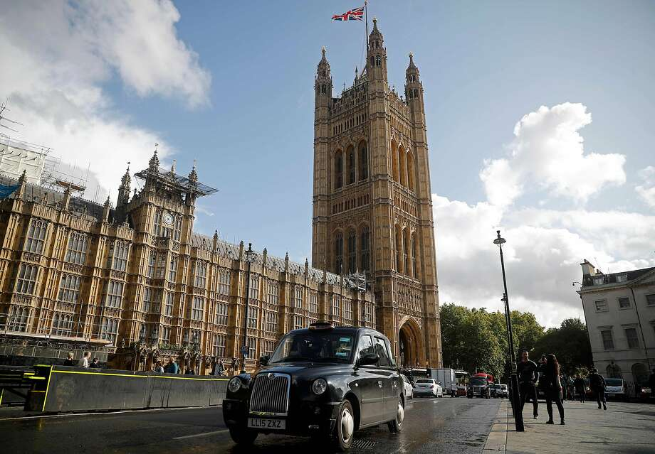 A black London taxi cab is drivens past the Houses of Parliament in central London on September 24, 2019. Photo: Tolga Akmen, AFP/Getty Images