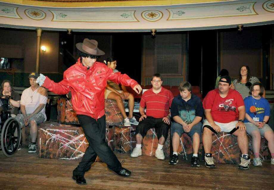Jason Stickle, foreground, dances his Michael Jackson parody, as fellow actors watch as he practices during rehearsal.   (Luanne M. Ferris / Times Union) Photo: LUANNE M. FERRIS