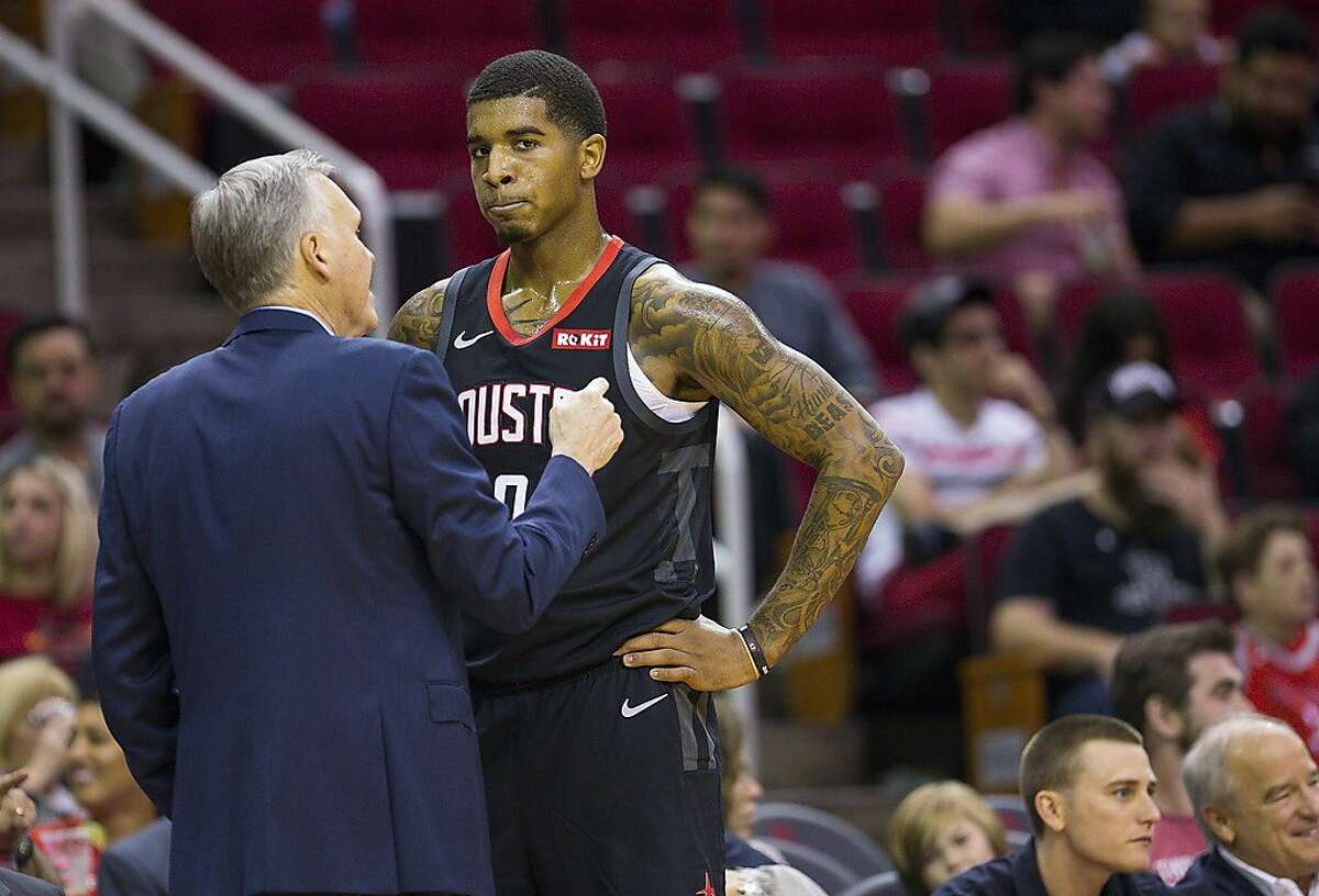 Houston Rockets head coach Mike D'Antoni talks with Houston Rockets forward Marquese Chriss (0) during the second half of the Rockets 104-85 loss to the Portland Trail Blazers, Tuesday, Oct. 30, 2018, at Toyota Center in Houston.
