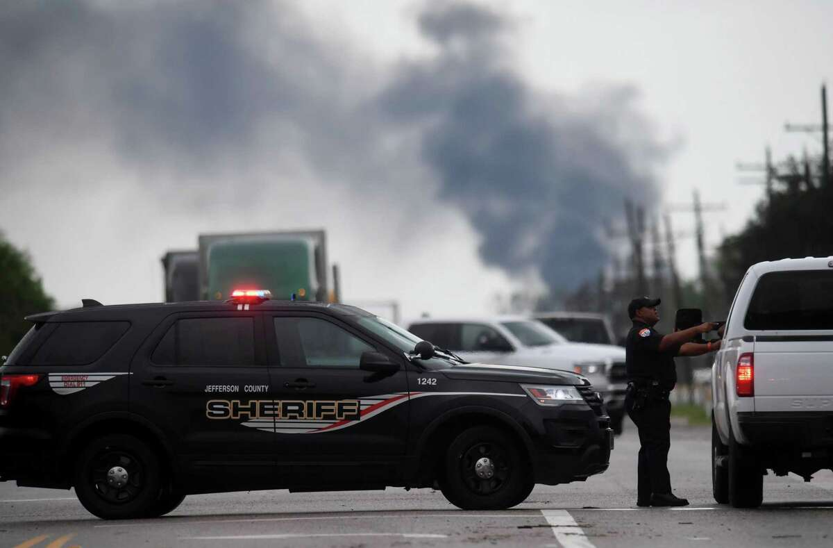 Black smoke from the Goodyear facility could be seen from Fannett as a Jefferson County deputy helps guide a motorist past Tropical Storm Imelda flooding. The Goodyear Tire & Rubber Beaumont Chemical Plant said Imelda flooded out the plant and caused it to lose power, which led to the release of 19,000 pounds of pollutants, including 15,000 pounds of hydrocarbons.