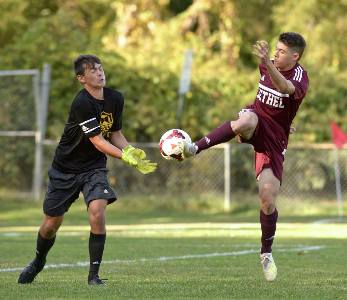 Weston keeper Devin Riley (1) tries to get to the ball before Bethel's Bryan Osebio (7) in their boys soccer game on Sept. 24 at Rourke Field in Bethel. Osebio was named to the All-New England boys soccer team on Thursday.