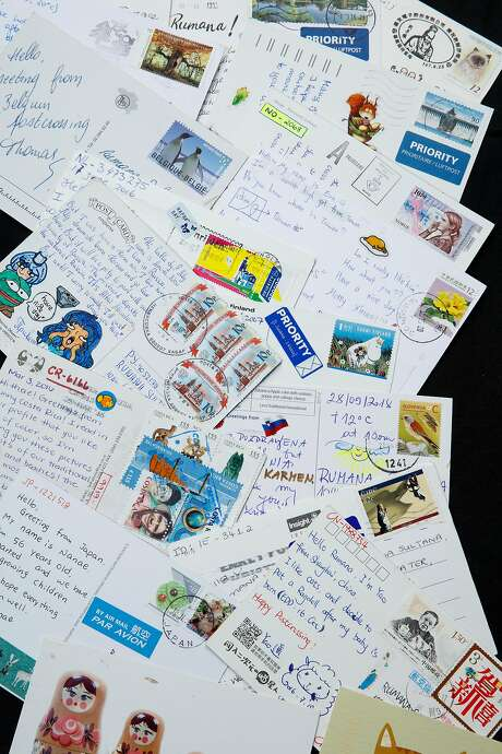 Part of Rumana Sultana's collection of over 3,000 postcards from around the world. Photo: Russell Yip / The Chronicle
