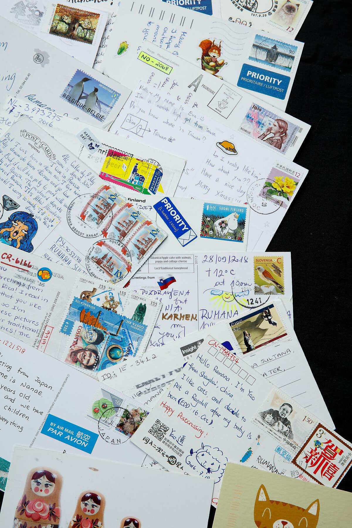 Part of Rumana Sultana's collection of over 3,000 postcards from around the world.