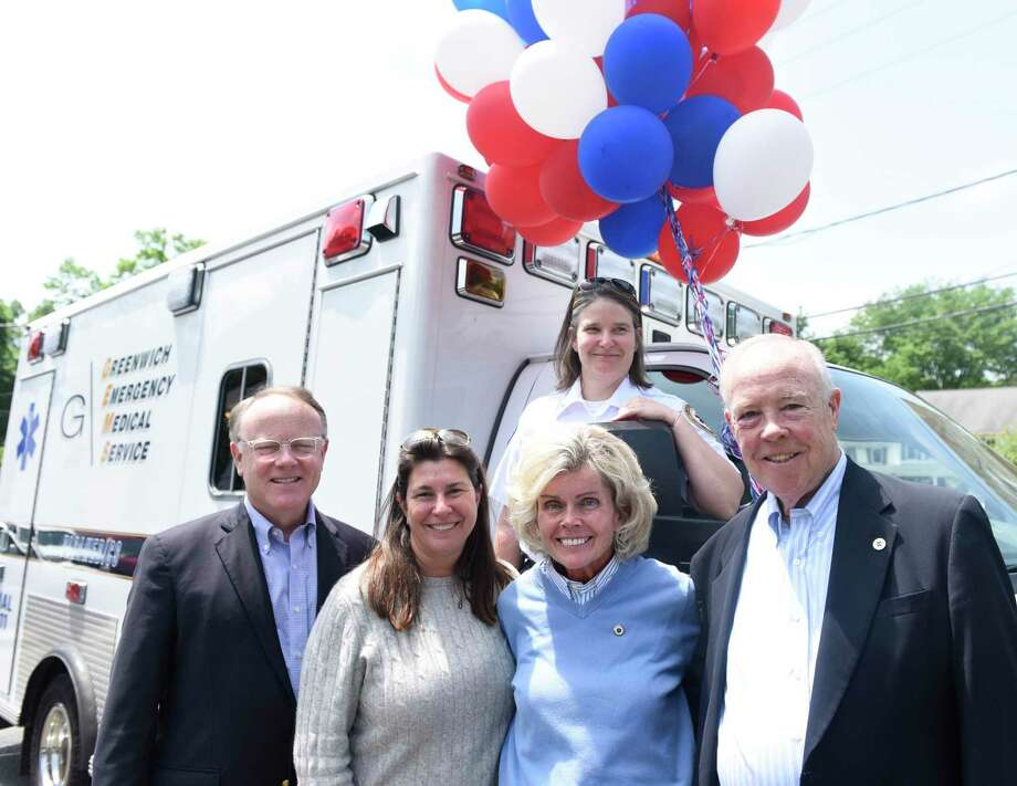 GEMS Executive Director Tracy Schietinger, back, GEMS Vice Chair Dan FitzPatrick, left, Cos Cobber owner Caren Vizzo, second from left, Event Chair Ann Hagmann, and GEMS board member and former Vice Chair Charles Kaufmann pose at the Greenwich Emergency Medical Service (GEMS) fundraiser at Caren's Cos Cobber in the Cos Cob section of Greenwich, Conn. Wednesday, May 30, 2018. Folks got a chance to tour an ambulance and meet GEMS employees with half the day's restaurant proceeds going to GEMS. Photo: Tyler Sizemore / Hearst Connecticut Media / Greenwich Time