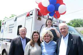 GEMS Executive Director Tracy Schietinger, back, GEMS Vice Chair Dan FitzPatrick, left, Cos Cobber owner Caren Vizzo, second from left, Event Chair Ann Hagmann, and GEMS board member and former Vice Chair Charles Kaufmann pose at the Greenwich Emergency Medical Service (GEMS) fundraiser at Caren's Cos Cobber in the Cos Cob section of Greenwich, Conn. Wednesday, May 30, 2018. Folks got a chance to tour an ambulance and meet GEMS employees with half the day's restaurant proceeds going to GEMS.
