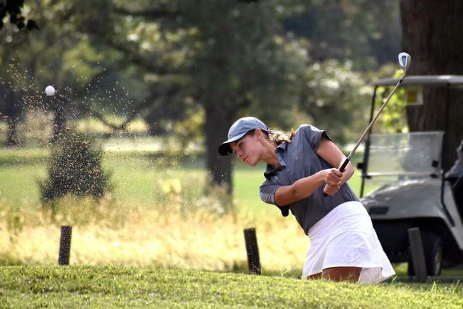 EHS freshman Nicole Johnson hits out of the bunker on No. 14 at the O'Fallon Invitational on Tuesday. Photo: Matt Kamp|The Intelligencer