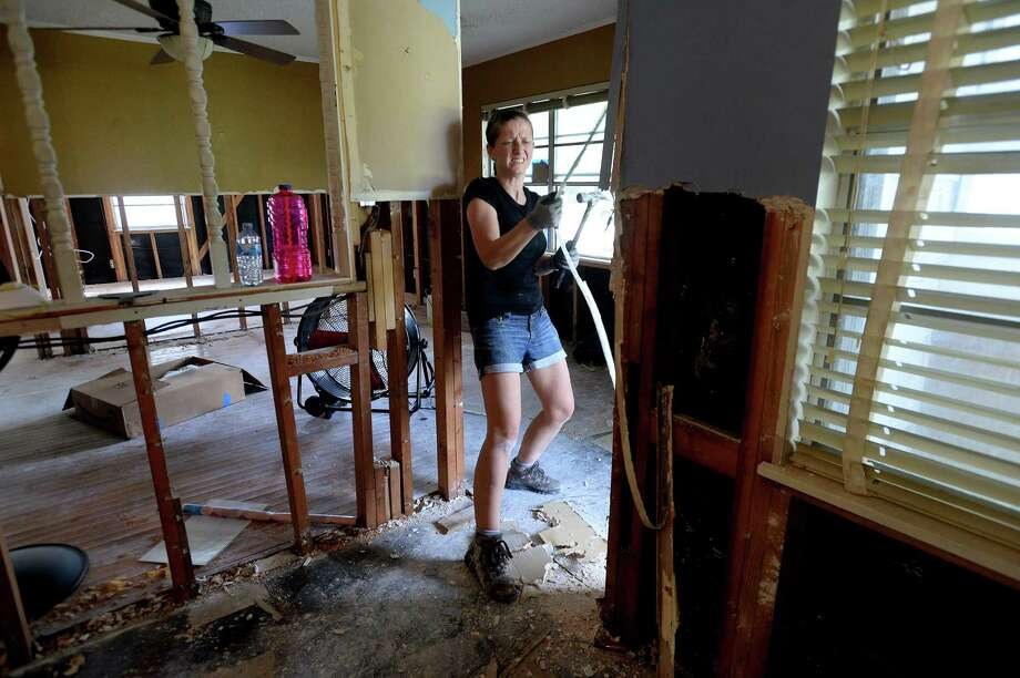 Kasia Ridgeway pulls at a piece of trim as she and fellow volunteers with her husband and pastor Robbby Ridgeway's church, Amelia Baptist, worked to gut a home on Morrogh Drive as residents throughout flooded Beaumont neighborhoods get to the work of gutting their damaged homes Tuesday. Photo taken Tuesday, September 24, 2019 Kim Brent/The Enterprise Photo: Kim Brent / The Enterprise / BEN