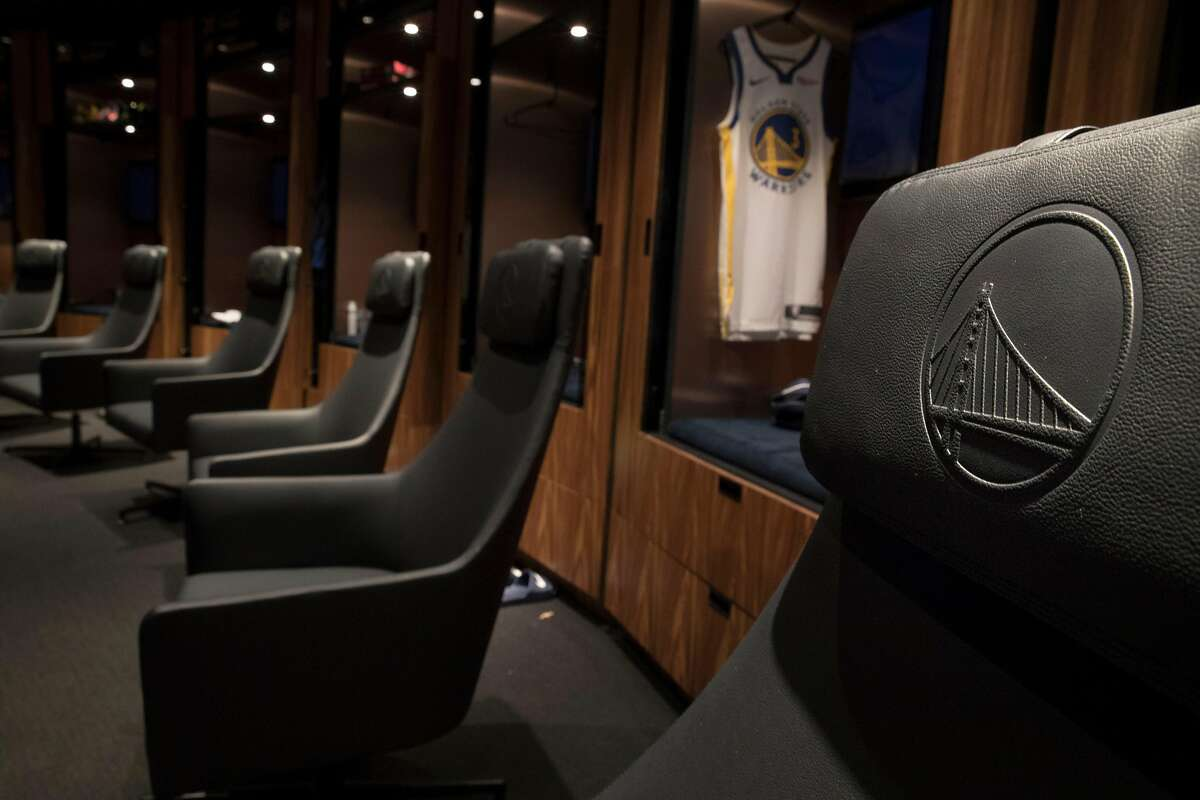 Player chairs with the Warriors logo embossed on the head rest in the locker room at Chase Center, the new home of the Golden State Warriors, in San Francisco, Calif., on Monday, September 23, 2019.