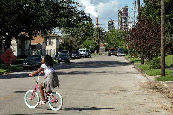 "Rhianna Winslow, 9, rides her bike in front of her house on Oklahoma Street on Tuesday, Sept. 24, 2019, in Baytown. Winslow said ""it stank"" the previous week."