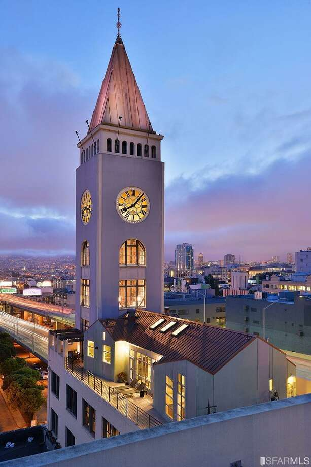 The penthouse comes with exclusive rights to the wraparound deck and the three-story clock tower. Photo: Compass