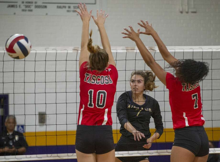 Midland High's Olivia Hale hits the ball past the reach of Tascosa's Bebe Irwin and Aaliyah Hardy 09/24/19 at Midland High gym. Tim Fischer/Reporter-Telegram Photo: Tim Fischer/Midland Reporter-Telegram